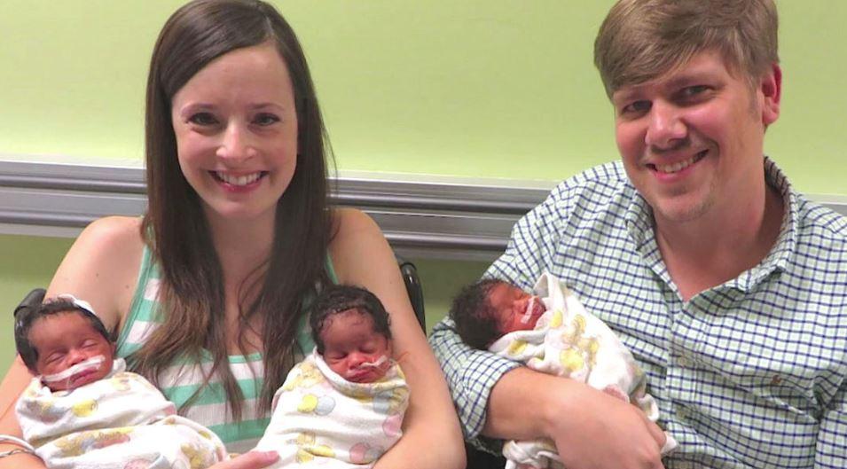 Baby girl black giving to birth Live birth: